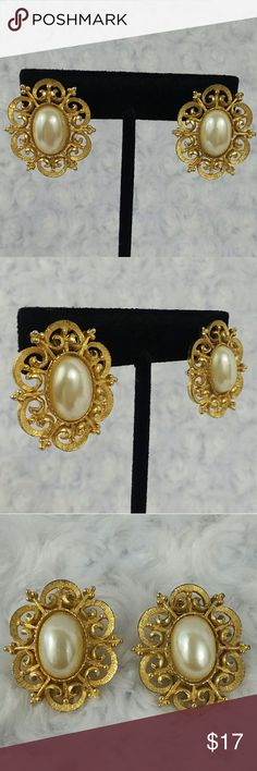 "VINTAGE Gold Scroll Earrings with Pearl Center An elaborate scrolled frame made of gold tone metal boldly framed a 5/8"" by 3/8"" creamy faux pearl cabochon. Made circa 1950s they have a French clip back that works perfectly. The entire earring measure 1 1/4"" tall by just over an inch wide. They are in excellent vintage condition. Other than mild finish loss on the back of one earring they are like new. Vintage Jewelry Earrings"