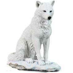 White Wolf Sculpture Sitting in Snow