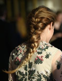 This intricate, dreamy four-strand braid on Olivia Palermo is a beautiful hairstyle to try for a wedding, dinner party, or music festival.