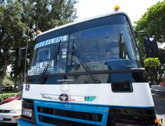 tips for taking public transportation in Costa RIca - bus fare and sign