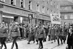 Pictured here is the deportation of Jews to Dachau concentration camp from Regensburg, Germany on November 10, 1938. On Kristallnacht, the synagogue and community center were burned to the ground, Jewish apartments were destroyed, and Jewish men, women, and children were arrested and humiliated. About 30 were sent to the Dachau concentration camp.Yad Vashem Photo Archives 195/C122