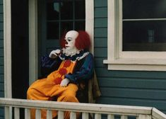 Tim Curry as Pennywise taking a break on the set of IT.