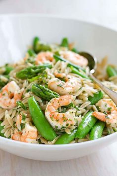 This Primavera Pasta Salad with Shrimp is fantastic for a light dinner or a picnic lunch! Packed with asparagus and snap peas.