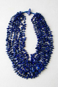 Deep blue Lapis has been admired since ancient times by mystics and royal families. Cleopatra wore Lapis jewelry and also wore the crushed stone for eye shadow. The color is like the deepest sea and is a symbol of wisdom and spiritual love. Eight strands of polished Lapis nuggets have been strung in a bib …