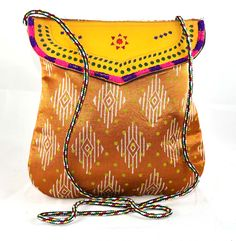 Bag is beautifully decorated with vintage style.* leather flap is decorated to give ethnic look.* Color: Multicolored.* One zipper enclosure pocket inside.* Leather flap cover top of the bag.* To hold itcomfortablybag comes with long handle. #Buyhandbagsonline #HandmadeHandbags #Authenticdesignerhandbags #Womenswallets #Pursesonline #Handmadeitems #Styleincraft