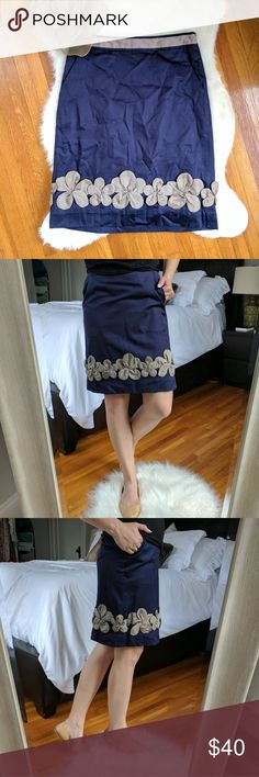 BODEN LIMITED EDITION   silk trim skirt Sateen cotton with silk trim around waistband and silk floral decoration around hem.  Impeccable condition. Navy blue, taupe silk.   Measurements:  Flat across waist 14 inches Flat across hips 18 inches  waist to hem 21 inches Boden Skirts Pencil