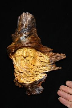 The difference between a wood nymph, wood spirit or greenman is the greenman has vines, leaves, etc. carved into or around the face.  The spirits or nymphs are usually carved with the grain of the wood.