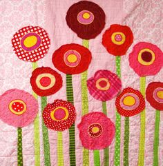 Poppy baby quilt wall art quilt in pinks reds: fun and whimsical quilt