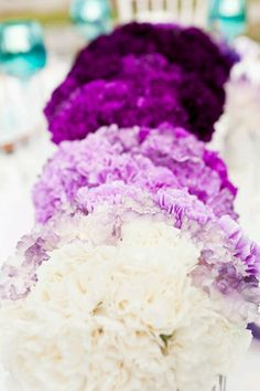 Ombre flowers! Bride has white and get darker with each bridesmaid.