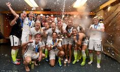 Champions! Team USA spray champagne and clutch their trophy after smashing Japan 5-2 in th...