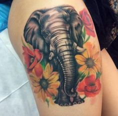 Floral elephant tattoo with an amazing shimmering trunk by Emma Kerr