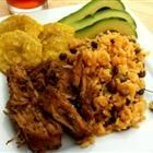 Puerto Rican style pork roast... we use leftovers for pulled pork sandwiches... yum!    Slow Cooker Pernil Pork Recipe