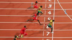 Usain Bolt crosses the line to win gold in the men's 100m final on Day 9 at London 2012.