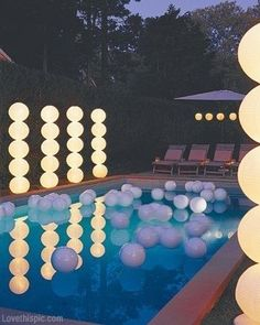Jaelynn LOVE this outdoor party decoration idea! The light columns next to the pool are paper lanterns that have been stacked on Christmas light covered wooden poles. So easy and they look amazing. I may have to throw a party just so I can use this idea! Grad Parties, Birthday Parties, Teen Pool Parties, Picnic Parties, 26th Birthday, Backyard Pool Parties, Wedding Backyard, Backyard Ideas, Pool Wedding