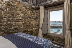 1 bedroom design holiday cottage with sea view in Mousehole cornwall by Beachspoke Mousehole Cornwall, Stone Cottages, Romantic Cottage, House Design, Sea, Luxury, Bedroom, Holiday, Furniture