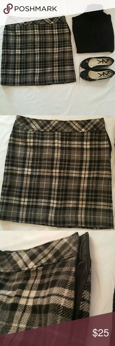 NWOT  LL BEAN Wool Skirt NWOT  LL Bean Wool Skirt - Size 16 - Never worn (slit in back is still stitched) - Lined - Side zipper and hook closure - Approximate Measurements laying flat below-  Waist - 19 inches  Hips- 22 inches  Length- 22 inches LL BEAN  Skirts