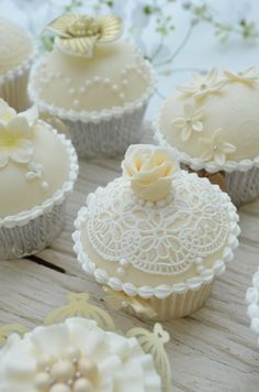 White and Ivory Wedding Cupcakes - by Hilary Rose Cupcakes @ CakesDecor.com - cake decorating website