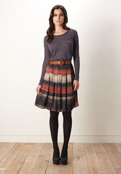 Ooooo, I like this outfit: black a-line skirt, brown cardigan ...