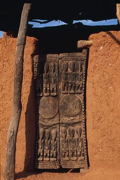 Africa | Carved wood door.  Dogon Country, Mali | ©Michel Renaudeau