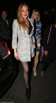Monochrome maven: Lindsay kept her look simple and chic with a black and white tweed-style...