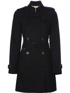 Black cotton trench coat from Burberry Brit featuring a classic collar, button epaulettes, a double breasted fastening, button tabs to the front and rear, a belted waist, two button pockets to the sides and a signature checked print lining.