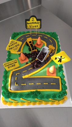Construction Zone Birthday Cake for 2-year-old. Excavator. Dump Truck. Road Construction Cake. www.VintageBakery.com (803) 386-8806