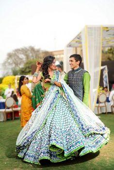 CTwirling bride in coral blue lehenga for mehendi function. See more on wedmegood.com #wedmegood #indianwedding #indianbride #lehenga #lehengacholi #bridallehenga #bridallehengacholi