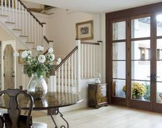 love the mixture of stained woodwork mixed with the white trim