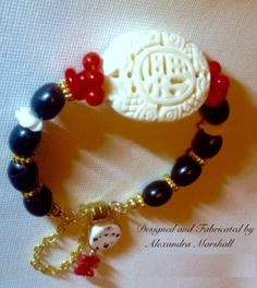 "You need this red, black, and cream bracelet by Alexandra Marshall to transition seasons. 7"" bracelet features hand carved white coral, natural black coral, & red coral accentuated with 14K gold fill & overlay (on brass), magnetic clasp & safety chain. #B1992. $69. To order gift boxed, double click photo."