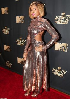 Shining star: Taraji P. Henson glittered in her rose gold gown with a turtleneck neckline ...