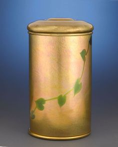 """This stellar Tiffany Studios humidor is crafted of that company's famed favrile glass Stamped """"TIFFANY STUDIOS/NEW YORK/22504/6;"""" the top features engraved monogram """"NCL"""" This is an exquisite example of the Art Nouveau style by Tiffany Studios Circa 1910 9 1/4"""" high $24.850"""