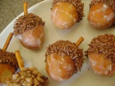 Acorn Treats - Donut Hole, Pretzel Stick, chocolate frosting + chocolate sprinkles. Our school doesn't allow cupcakes for birthdays, this would be a perfect party treat to make instead!