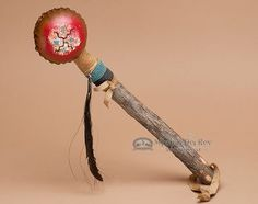 This is a genuine Native American rattle perfect for dance, music, medicine or meditation hand made by Navajo Indian artists. This American Indian rattle features a real rawhide shaker head with a bur