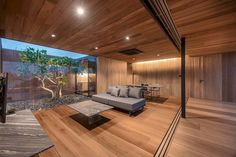 Image 16 of 33 from gallery of The Skyscape Rooftop House / WARchitect. Photograph by Rungkit Charoenwat Casas Country, Internal Courtyard, Kitchens And Bedrooms, Home Ceiling, Small House Design, Wooden House, Sliding Glass Door, Rooftop, Modern Architecture