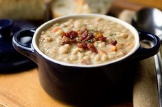 A comforting creamy white bean stew with smoky thick-cut bacon, tender vegetables and fragrant herbs.