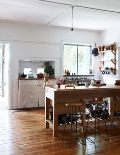 The kitchen of Matt and Lentil Purbrick in their Tabilk home in central Victoria. The recycled timber kitchen cabinets were designed by Matt and built by Jack Robinson, while the stool bases were built by friend Hugh Williams. Photo by Eve Wilson, styling by Stefanie Stamatis for The Design Files.