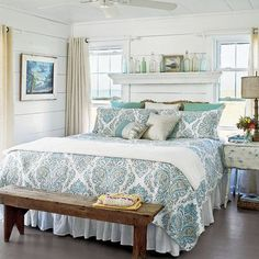 "Cottage-Style Beach House Bedroom | A blue-and-green patterned duvet and accent pillows add a lively touch to the master bedroom in this Bald Head Island, North Carolina, cottage. ""I kept the decor simple but comfortable,"" says designer and homeowner Tiffany McWhorter."