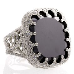 """Erica Courtney Ring """"Lola"""". Award winning ring is intercut and has exceptional detail around the entire setting with a black diamond center."""