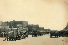 Main Street old cars trucks 1930s image Broken Arrow OK