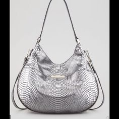 """Milky Layne Snake Embossed Bucket Hobo Bag Brand new Milly Layne Snake-Embossed Leather Bucket Bag Adjust this bucket-style Milly bag to your day with a convenient, expandable design—keep it open when extra-stuffed or zipped flat for lighter travel.Snake-embossed metallic - silver hardware. Top handle has 10"""" drop. Removable shoulder strap; 20"""" drop.Magnetic closure tops slouchy hobo shape. Exterior slide pocket with engraved logo plate.Inside, fabric lining; one zip and two open…"""