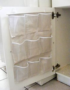 Clever Ideas Simple storage: Use shoe-pockets for on-hand cleaners.