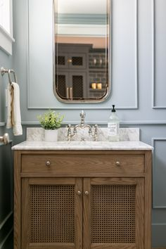 A refined coastal style defines this bath console. The cupboard doors are woven of rattan for an airy, open feel, and an adjustable shelf offers ample storage. A Seadrift finish on the wood adds a sun-drenched look. Single Sink Vanity, Vanity Sink, Restoration Hardware Bathroom, Pottery Barn Bathroom, Ranch Homes For Sale, Countertop Backsplash, California Ranch, Cabinet Paint Colors, Colored Ceiling