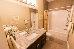 This 4 piece main bathroom is perfectly simple. photo by Digital Video Listings.