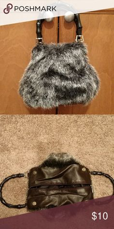 """Cute fuzzy purse Small faux fur purse with plastic handles, zip and snap closures. Single small zip pocket inside. Cute for a fun night out. 6.5"""" deep, 6"""" wide on bottom. Bags Mini Bags"""