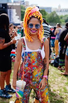 Everything about this look is on point: The braids, the paint-splattered overalls, oversized sunnies, pink watch, purple lip, and that bag. GIMME!