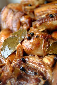 Adobo recipe - Filipino adobo is a stew or a simmer of meat or vegetables cooked with vinegar. The most common versions uses chicken or pork or both, with soy sauce to flavour, as well as bay leaf, black pepper, and garlic. #filipino #chicken #pork