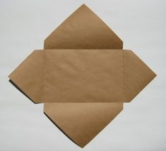"Easy Envelopes for Handmade Cards .Directions:  1. Lay your card diagonally on a square piece of paper that's just a little larger than your card on each side.  (If you make your card from an 8 1/2"" x 11"" or 9"" x 12"" paper folded in half, then a 12"" x 12"" square will work perfectly for the envelope.  For a small 4"" x 5"" card, a 7"" x 7"" square will work well.)  2. Fold each side up over the card, beginning with one of the shorter sides and ending with one of the longer sides.  If you lightly ""..."