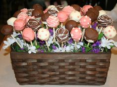 This is an edible cheesecake pop arrangement I made for Ladies' Tea at my church.