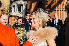 Bride wears a faux fur cover up for her autumn wedding | Photography by http://www.brighton-photo.com/