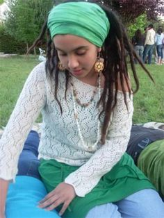 She is soooo cute! Love the outfit, accessories, and dreadlocks!